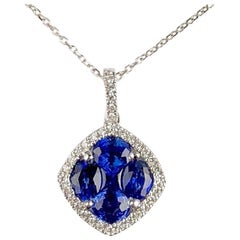 1.09 Carat Sapphire and 0.13 Carat Diamond Halo Pendant in 18 Karat White Gold