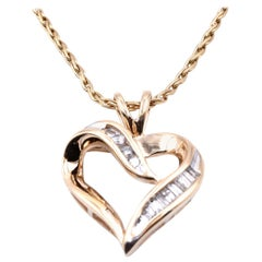 14 Karat Yellow Gold Diamond Heart Pendant
