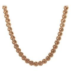 14 Karat Yellow Gold Swirl Link Necklace