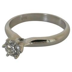 18 Carat White Gold F Color Half Carat Solitaire Diamond Ring