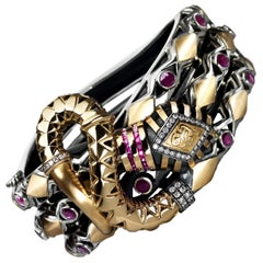 18 Karat Gold, Sterling Silver, Ruby and Diamond Limited Entwined Snake Bangle