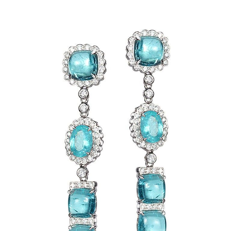 Trinity long earrings set in 18K white gold with 15.36cts paraiba tourmaline and 1.19cts diamond.