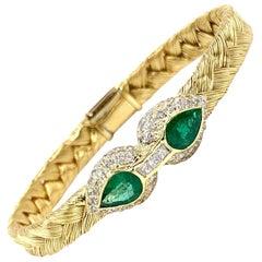 18 Karat Woven Bangle with Emeralds and Diamonds