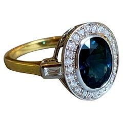 18 Karat Yellow and White Gold Blue Sapphire Diamond Cocktail Ring
