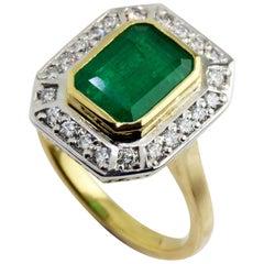 18 Karat Yellow and White Gold Emerald and Diamond Ring
