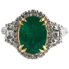1.93 Carat Oval Cut Emerald and Diamond Ring in 18k White and Yellow Gold