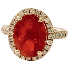 3.00 Carat AAA Oval Fire Opal Set in Diamond Halo Ring in 18 Carat Yellow Gold
