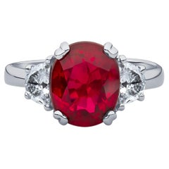 3.11 Carat Oval Cut Natural Thai Ruby Ring with 0.50 Carat Total of Diamonds