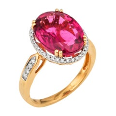 7.13 Carat Oval Shaped Rubelite Ring in 18 Karat Yellow Gold with Diamonds