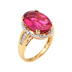 7.99 Carat Oval Shaped Rubelite Ring in 18 Karat Yellow Gold with Diamonds
