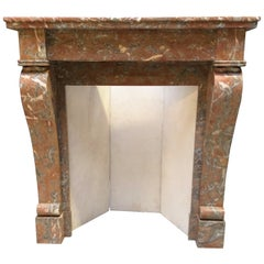 Small and Lovely Antique Fireplace in Soft Colors