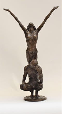 Bronze statue of sitting man and woman balancing on the back - Kees Verkade