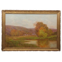 Pastoral Landscape of a Small Town with Hills and a Lake