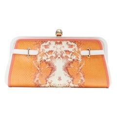 ALEXANDER MCQUEEN orange printed scaled leather gold crystal skull clutch bag