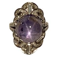 Amazing 25.50 Carat Blue Violet Star Sapphire and Diamond Platinum Art Deco Ring