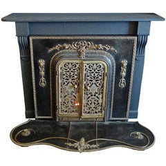 American 1960s Metal Bronze Faux Electric Fireplace with Hearth and Wood Mantel