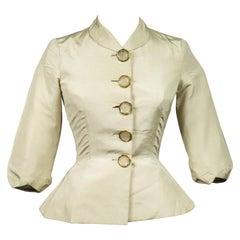 An Elsa Schiaparelli Bar Jacket in Cream Silk Numbered 89254 Circa 1947-1950