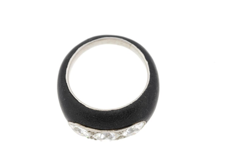 A rare Art Deco ring made in platinum and ebony set with three Old European Cut diamonds across the finger circa 1930. The organic nature of the ring is evident in the subtle texture of the dark wood. The inside of the ring and the stones are set in