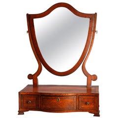 Antique English Georgian Flame Mahogany Shield Form Shaving Mirror, circa 1810