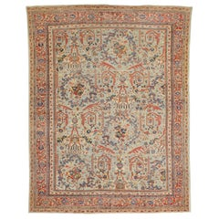 Antique Persian Sultanabad Rug with Blue and Red Botanical Motifs