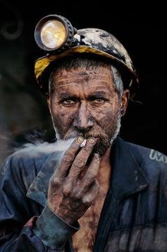 Smoking Coal Miner, Pol-E-Khomri, Afghanistan, 2002 - Colour Photography