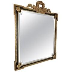 Louis XVI Style Giltwood and Ebony Beveled Glass Mirror