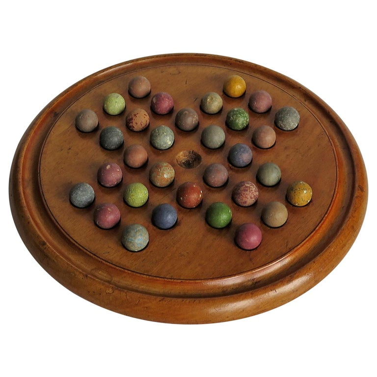 Victorian Marble Solitaire Game with Mahogany Board and 32 Handmade Marbles For Sale