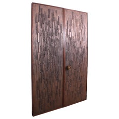 Bronze Brutalist Doors by Forms and Surfaces