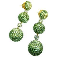 18K White gold invisiYellow, Green Sapphire Gold Graduated Three Balls Earrings