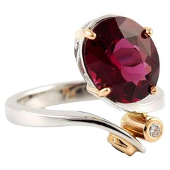 Kian Design 18 Carat Three Stones Oval Rhodolite and Round Diamond Ring