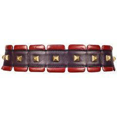 1988 AZZEDINE ALAIA red and purple leather runway belt with brass pyramid studs