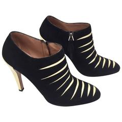 ALAIA black and creme suede ankle boots