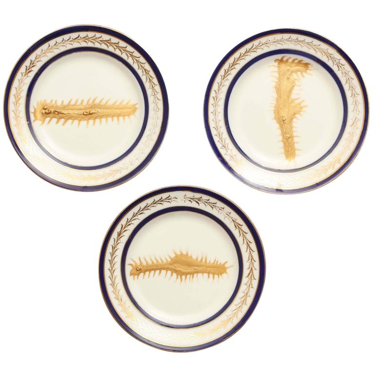 This Contemporary Hand Painted Blue And Gold Ocean Plate Collection