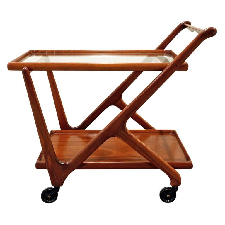 Rolling serving cart in lacquered mahogany with glass by Cesare Lacca (Italy) for Cassina, American, 1970s.