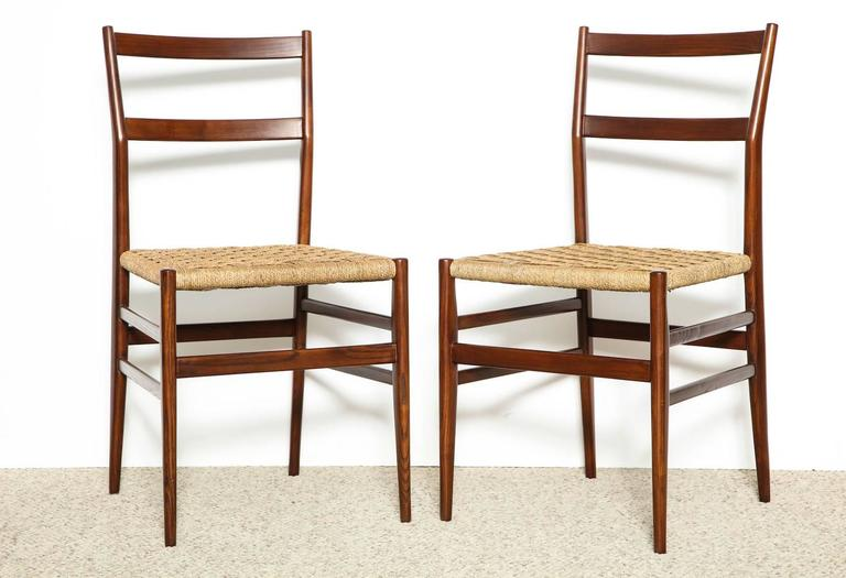 Set of 10 superleggera chairs by Gio Ponti for Cassina. These iconic chairs are one of his most famous models. Sculptural frame of solid ash, with woven seats and slatted backs. Set of ten side chairs with newly woven seats. *Currently only four