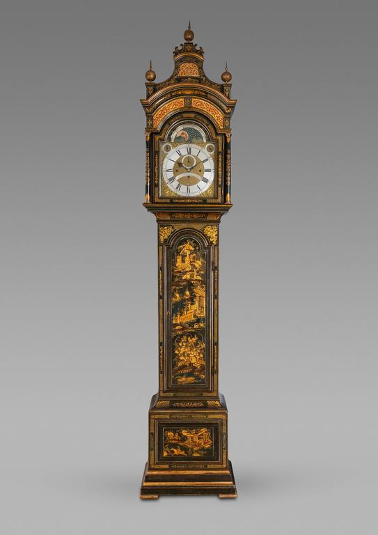 An extremely fine and imposing antique George III period chinoiserie decorated London made longcase clock by John Monkhouse.  This very fine clock has a pagoda top with giltwood spire finials and elaborately pierced sound frets. The hood is