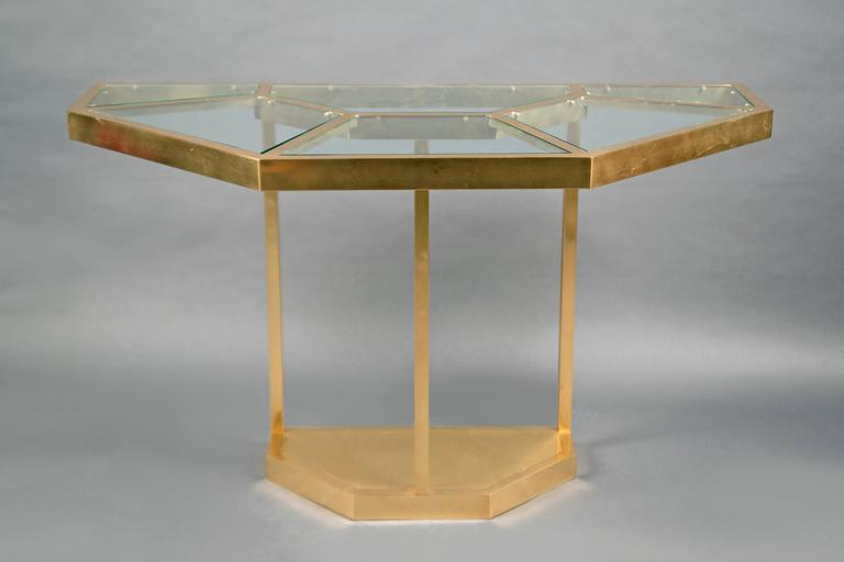 "Hexagonal brass structure, the top inlaid with clear glass pieces. The table can be separated in two halves and be used as consoles. Model ""Puzzle"" from the Series Plurimi."