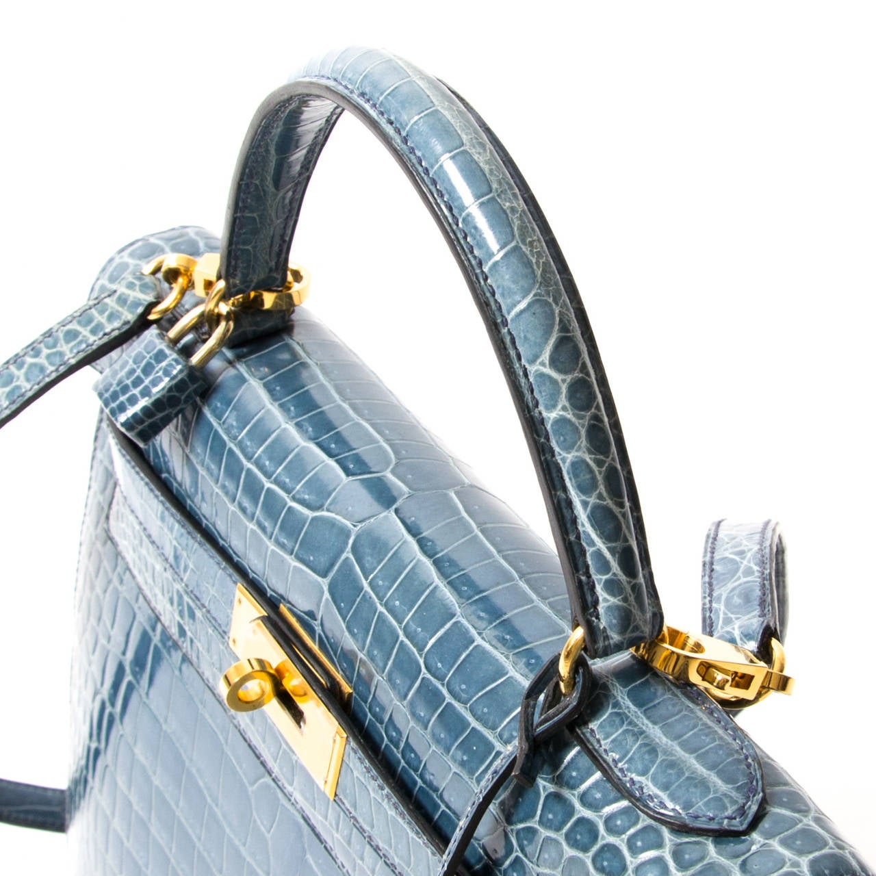 A rare Hermès Extraordinary Blue Jean Crocodile Porosus Kelly Bag Gold Hardware.  A must for any serious collector.  This particular Kelly bag is made from precious exotic leather, crocodile Porosus. The Crocodile leather has a beautifully