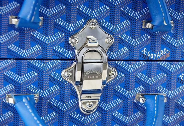 Guaranteed authentic numbered Limited Edition blue Goyard trunk which opens to reveal 2 removable Palladium plated doggy bowls! Rare to find in the blue. Trunk is blue logo canvas with blue leather trim. Inside the Palladium bowls are secured on a