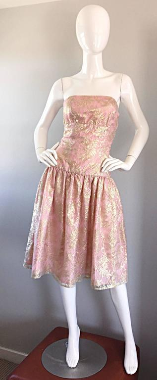 Prettiest vintage Halston strapless cocktail dress! Vibrant light pink, with an overlay of gold metallic lace. Slight drop waist, with a full skirt (could easily put a crinoline/petticoat under for a fuller skirt). Hidden zipper up the side, with