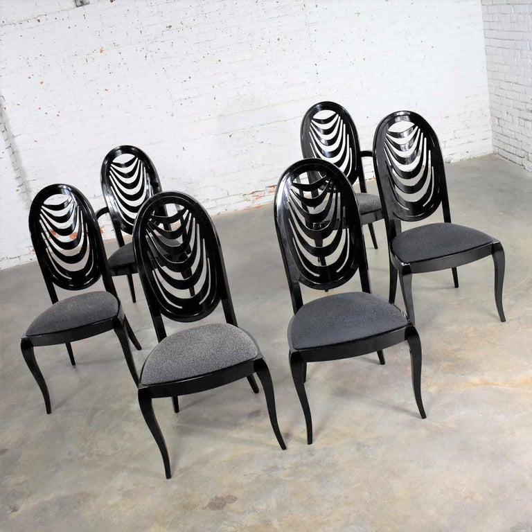 Incredible set of six black lacquer dining chairs with an oval drape back design by Pietro Costantini for Ello. There are four side chairs and two captain's or armed chairs. They are in wonderful condition. There were age related nicks and dings to