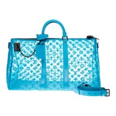 BRAND NEW Louis Vuitton Keepall Bandouliere Triangle 50 in turquoise mesh !