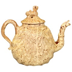 British Pottery Solid Agate Pecten Shell Teapot and Cover, circa 1755-1760