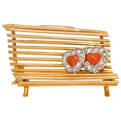 "Cartier 1940s Gold, Diamond, and Coral ""Lovers on a Bench"" Brooch"