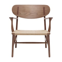 CH22 Lounge Chair in Wood with Natural Papercord Seat by Hans J. Wegner