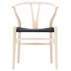CH24 Wishbone Chair in Wood Finishes with Black Papercord Seat by Hans J. Wegner