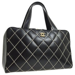 Chanel Black Leather Gold Carryall Travel Stitch Top Handle Satchel Bag