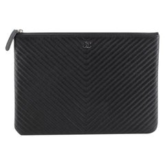 Chanel O Case Clutch Chevron Caviar Medium