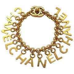 CHANEL Turnlock CC Gold Charm Bracelet