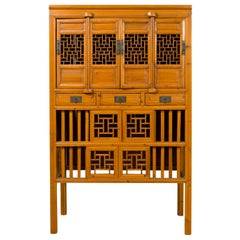 Chinese Qing Dynasty Elm Cabinet with Fretwork Motifs, Doors and Sliding Panels